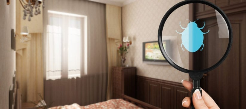 Woman with magnifying glass in bedroom