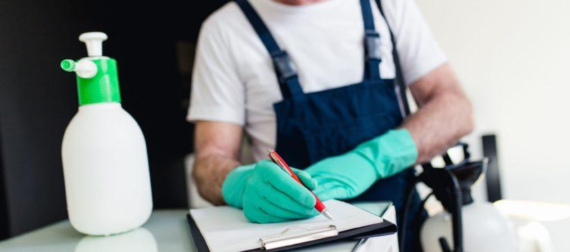 Pest control man signing paper